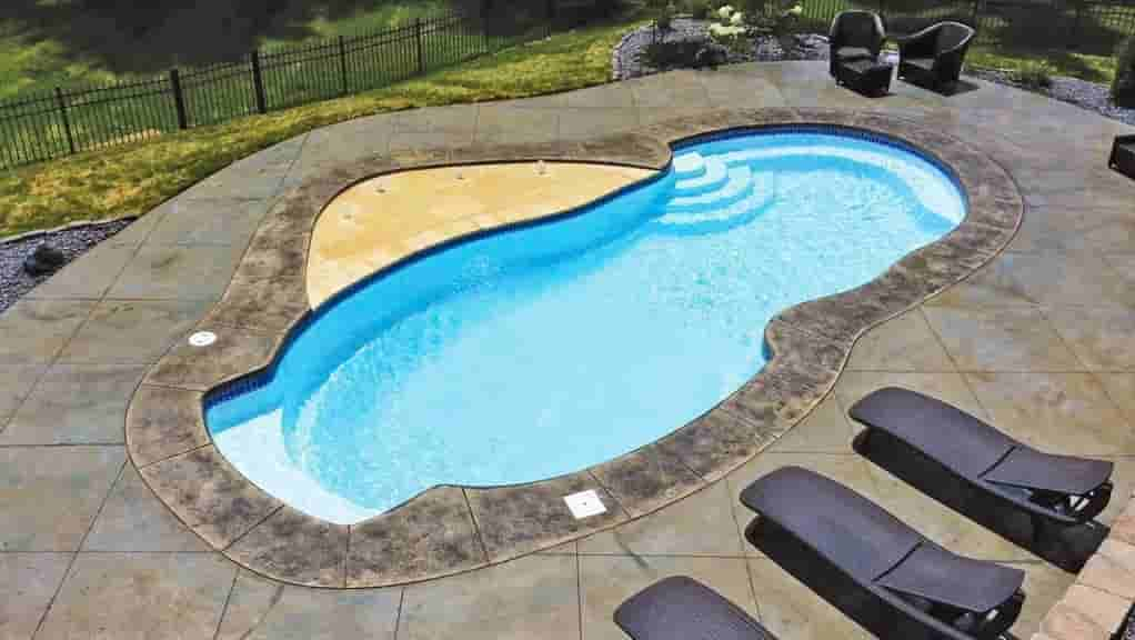 custom shaped pool with custom concrete