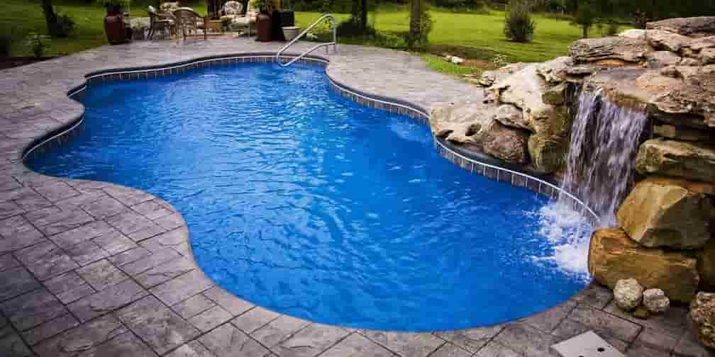 concrete stamped with a custom pool and rock waterfall
