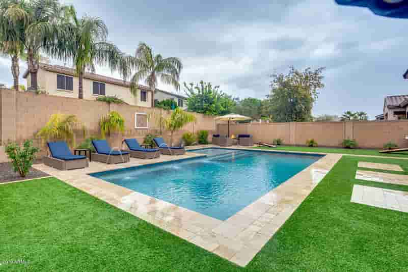 bright green grass with new concrete rectangle pool